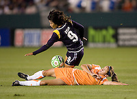 Sky Blue midfielder Jen Buczkowski takes down LA Sol forward Han Duan. The LA Sol defeated Sky Blue FC 1-0 at Home Depot Center stadium in Carson, California on Friday May 15, 2009.   .