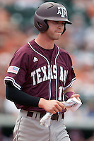 Texas A&M Aggies outfielder Tyler Naquin #18 walks to first base during the NCAA baseball game against the Texas Longhorns on April 28, 2012 at UFCU Disch-Falk Field in Austin, Texas. The Aggies beat the Longhorns 12-4. (Andrew Woolley / Four Seam Images).