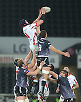 Ulster lock Dan Tuohy beats Ospreys number 8 Tyler Ardron to the line out ball.<br /> Guiness Pro12<br /> Ospreys v Ulster<br /> 20.12.14<br /> ©Steve Pope -SPORTINGWALES