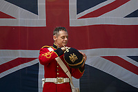 BNPS.co.uk (01202 558833)<br /> Pic: Zachary Culpin/BNPS<br /> <br /> Pictured: Carl Bowdidge inspects his uniform.<br /> <br /> Dressed to impress - The Nothe Fort Artillery were on parade in front of a huge Union Jack to celebrate Heritage Open Day in Weymouth, Dorset today (Sunday).<br /> <br /> The Nothe Fort, which was built between 1860 and 1872, opened its doors for free to mark England's largest festival of history and culture.
