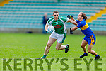 Jamie Lowhan of Na Gaeil been tackled by Robbie Cassidy of Michael Cusacks in the Munster Junior Club Football Championship semi final in Austin Stack Park on Saturday.