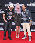 Brad Paisley, Kesha Rose Sebert and Christopher Bridges attends The Disney PLANES: FIRE & RESCUE Premiere held at The El Capitan Theatre in Hollywood, California on July 15,2014                                                                               © 2014 Hollywood Press Agency
