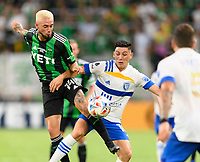 AUSTIN, TX - JUNE 19: Diego Fagundez #14 of Austin FC and Cristian Espinoza #10 of the SJ Earthquakes battle for control of a loose ball during a game between San Jose Earthquakes and Austin FC at Q2 Stadium on June 19, 2021 in Austin, Texas.