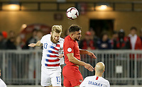 TORONTO, ON - OCTOBER 15: Tim Ream #13 of the United States and Lucas Cavallini #19 of Canada battle in the air for a ball during a game between Canada and USMNT at BMO Field on October 15, 2019 in Toronto, Canada.