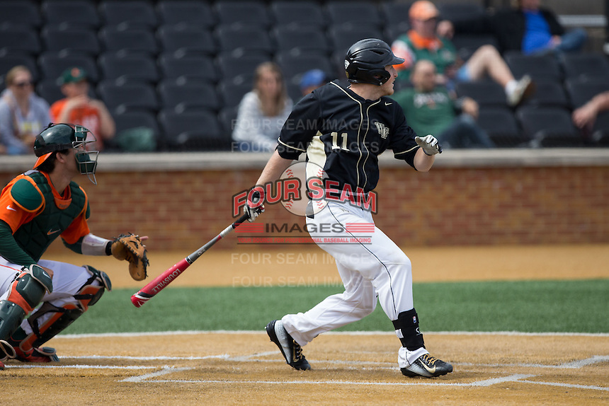 Jonathan Pryor (11) of the Wake Forest Demon Deacons follows through on his swing against the Miami Hurricanes at Wake Forest Baseball Park on March 22, 2015 in Winston-Salem, North Carolina.  The Demon Deacons defeated the Hurricanes 10-4.  (Brian Westerholt/Four Seam Images)