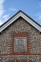 The R&G monogram on one of the flint buildings on the estate may pertain to the houses of Richmond and Greville. The 6th duke, Charles Gordon Lennox married Frances Harriet Greville in 1843
