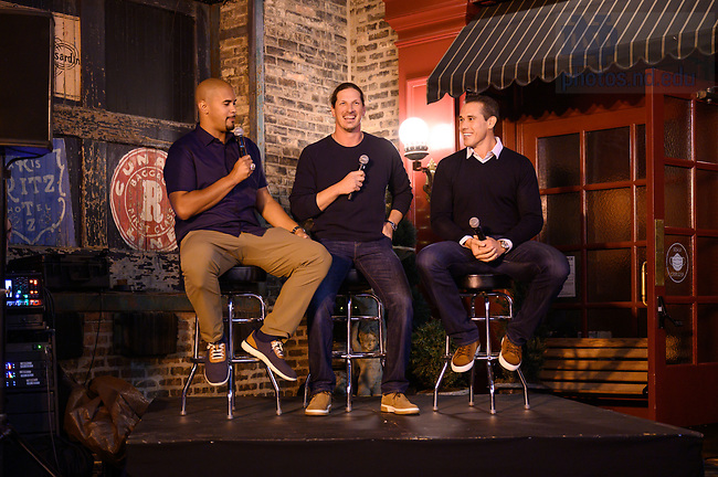 """September 24, 2021; Former Notre Dame football players (l-r) Ryan Harris, Jeff Samardzija and Brady Quinn speak at the """"Rally in the Alley"""" event, part of the 2021 Shamrock Series in Chicago. (Photo by Matt Cashore/University of Notre Dame)"""