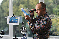 BNPS.co.uk (01202 558833)<br /> Pic: ZacharyCulpin/BNPS<br /> <br /> Pictured: David looks at his masterpiece in a viewing dome<br /> <br /> A collection of micro masterpieces so tiny they fit inside the eye of a needle have sold for a whopping £90,000.<br /> <br /> Micro artist David Lindon has recreated iconic artworks including Van Gogh's Starry Night in miniature form - each measuring just 0.5mm wide.<br /> <br /> David, who lives in Bournemouth, Dorset, uses a variety of micro-plastics to carve and paint his tiny pieces, with the aid of a microscope, and each one took months of painstaking work to complete.