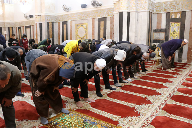 Palestinians perform a night prayer known as ''Tarawih'' Ibrahimi mosque, also known as the Tomb of the Patriarchs in the West Bank city of Hebron on April 12, 2021. The Grand Mufti of Jerusalem and Palestine, Mohammad Hussein, declared that tomorrow, April 13, will be the first day of the Muslim holy fasting month of Ramadan. Photo by Mosab Shawer
