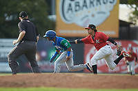 Rudy Martin (12) of the Lexington Legends is tagged out by Kannapolis Intimidators second baseman Ramon Beltre (1) as umpire Mitch Leikam looks on at Kannapolis Intimidators Stadium on August 4, 2019 in Kannapolis, North Carolina. The Legends defeated the Intimidators 5-1. (Brian Westerholt/Four Seam Images)