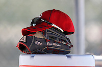 Washington Nationals outfielder Bryce Harper #34 hat, glove, and sunglasses on top of the cooler during an Instructional League game against the national team from Italy at Carl Barger Training Complex on September 28, 2011 in Viera, Florida.  (Mike Janes/Four Seam Images)