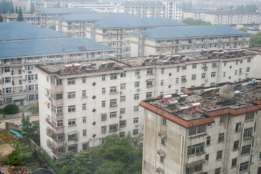 Yangzhou, Jiangsu, China.  Solar Water Heaters on Rooftops of Apartment Buildings.  Air Pollution.