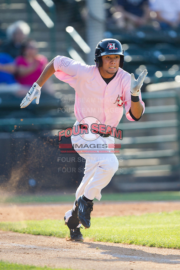 Isiah Kiner-Falefa (48) of the Hickory Crawdads hustles down the first base line against the Augusta GreenJackets at L.P. Frans Stadium on May 11, 2014 in Hickory, North Carolina.  The GreenJackets defeated the Crawdads 9-4.  (Brian Westerholt/Four Seam Images)