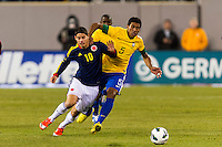 James Rodriguez (10) of Colombia and Paulinho (5) of Brazil. Brazil (BRA) and Colombia (COL) played to a 1-1 tie during international friendly at MetLife Stadium in East Rutherford, NJ, on November 14, 2012.