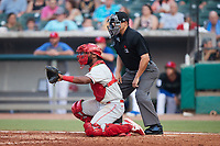 Chattanooga Lookouts catcher Chuckie Robinson (25) sets a target as home plate umpire Robert Nunez looks on during the game against the Tennessee Smokies at Smokies Stadium on July 31, 2021, in Kodak, Tennessee. (Brian Westerholt/Four Seam Images)