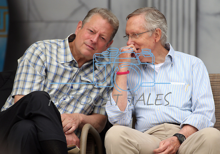 Former Vice President Al Gore and Senate Majority Leader Harry Reid talk at the 17th annual Lake Tahoe Summit conference at Sand Harbor, near Incline Village, Nev., on Monday, Aug. 19, 2013. <br /> Photo by Cathleen Allison