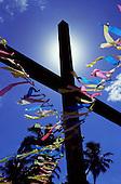 Itaparica Island, Bahia State, Brazil; cross decorated for Candomble and Roman Catholic syncretic festival.