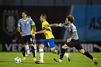 17th November 2020; Centenario Stadium, Montevideo, Uruguay; Fifa World Cup 2022 Qualifying football; Uruguay versus Brazil; Nahitan Nández of Uruguay  pulls back Arthur of Brazil