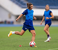 TOKYO, JAPAN - JULY 20: Tobin Heath #7 of the USWNT crosses the ball during a training session at the practice fields on July 20, 2021 in Tokyo, Japan.