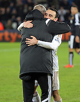 Swansea manager Alan Curtis celebrates his team's win with Leon Britton after the Barclays Premier League match between Swansea City and Watford at the Liberty Stadium, Swansea on January 18 2016