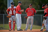Ball State Cardinals head coach Rich Maloney (2) makes a pitching change as catcher Erek Bolton (11) and William Baker (32) look on during a game against the Mount St. Mary's Mountaineers on March 9, 2019 at North Charlotte Regional Park in Port Charlotte, Florida.  Ball State defeated Mount St. Mary's 12-9.  (Mike Janes/Four Seam Images)
