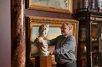 BNPS.co.uk (01202) 558833<br /> Pic: ZacharyCulpin/BNPS<br /> <br /> Art uncovered<br /> <br /> Curator, Duncan Walker moves an artwork by Henri Emile Allouard into position before the museum reopening<br /> <br /> Staff at the Russell-Cotes Art Gallery & Museum in Bournemouth prepare for reopening next week after the Coronavirus pandemic lockdown.<br /> <br /> In 1907 husband and wife Merton and Annie Russell-Cotes donated East Cliff Hall and its contents including a fine art collection as a museum to the town of Bournemouth. The couple travelled extensively visiting Australasia, America, India, the Near East, Egypt, the Pacific Islands and Japan, collecting artwork and souvenirs.<br /> After they died the Borough of Bournemouth managed East Cliff Hall before it opened as the Russell-Cotes Art Gallery and Museum in 1922.