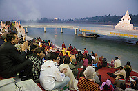 India, Rishikesh.  Sunset Worship (Aarti) on the Ganges (Ganga) at Parmarth Niketan Ashram.  Lord Shiva on Right.