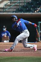 Sauryn Lao (5) of the Rancho Cucamonga Quakes bats against the Inland Empire 66ers at San Manuel Stadium on May 9, 2021 in San Bernardino, California. (Larry Goren/Four Seam Images)