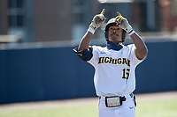 Michigan Wolverines outfielder Clark Elliott (15) celebrates after hitting a home run during the NCAA baseball game against the Illinois Fighting Illini on March 20, 2021 at Fisher Stadium in Ann Arbor, Michigan. Michigan won the game 8-1. (Andrew Woolley/Four Seam Images)