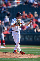 Oregon State University starting pitcher Christian Chamberlain (34) delivers a pitch during an NCAA game against the New Mexico Lobos at Surprise Stadium on February 14, 2020 in Surprise, Arizona. (Zachary Lucy / Four Seam Images)
