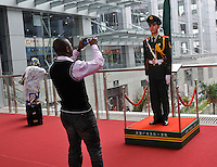 A businessman take picture of a PLA soldier at the world's largest trade fair, China Import and Export Fair (Canton Fair) in Guangzhou,  China,. The trade fair which last the month of April draws to gather manufacturers from across China and attracts businessmen from around the world..26 Apr 2009