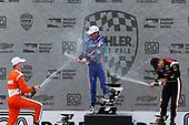 Verizon IndyCar Series<br /> Kohler Grand Prix<br /> Road America, Elkhart Lake, WI USA<br /> Sunday 25 June 2017<br /> Josef Newgarden, Team Penske Chevrolet Scott Dixon, Chip Ganassi Racing Teams Honda Helio Castroneves, Team Penske Chevrolet podium champagne<br /> World Copyright: Michael L. Levitt<br /> LAT Images