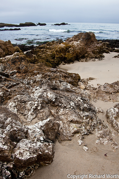 Sand, rocks and gentle waves - a morning at Pescadero State Beach, California.