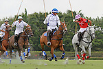 WELLINGTON, FL - MARCH 05: Orchard Hill's Facundo Pieres (Red) takes a shot on goal while being pursued by Bob Jornayvaz, Adolfo Cambiaso, and Matias Torres Zavaleta of Valiente, as Valiente defeats Orchard Hill 14-11, in the 26 goal CV Whitney Cup Final, at the International Polo Club, Palm Beach on February 26, 2017 in Wellington, Florida. (Photo by Liz Lamont/Eclipse Sportswire/Getty Images)