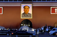 Mao illuminated, on Tiananmen gate at dusk, showing visitors and PLA soldier on guard..06 Jan 2005