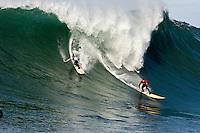 Grant Washburn and Greg Long ride the waves fury at Mavericks Surf Contest 2008.  Half Moon Bay, Ca.  January 12, 2008.
