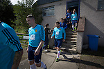Harestanes AFC v Girvan FC, 15/08/2015. Scottish Cup preliminary round, Duncansfield Park. The players emerging from the dressing rooms before Harestanes AFC (in light blue) take on Girvan FC in a Scottish Cup preliminary round tie, staged at Duncansfield Park, home of Kilsyth Rangers. The home team were the first winners of the Scottish Amateur Cup to be admitted directly into the Scottish Cup in the modern era, whilst the visitors participated as a result of being members of both the Scottish Football Association and the Scottish Junior Football Association. Girvan won the match by 3-0, watched by a crowd of 300, which was moved from Harestanes ground as it did not comply with Scottish Cup standards. Photo by Colin McPherson.