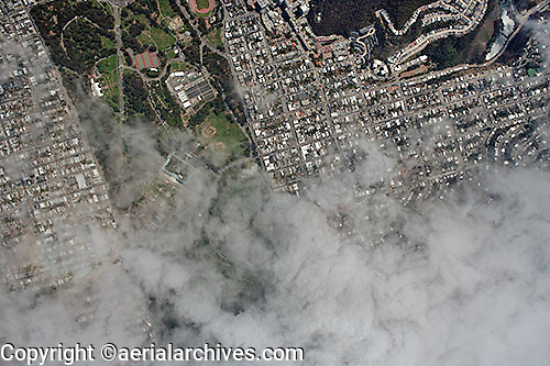 aerial photograph of fog moving in over Golden Gate Park, San Francisco, California