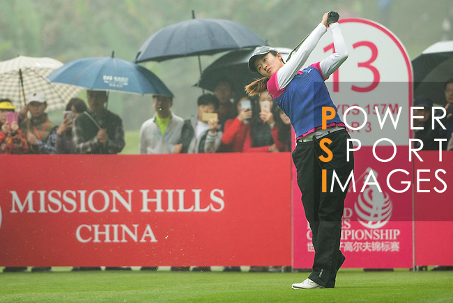 Liu Yu of China tees off at the 13th hole during Round 4 of the World Ladies Championship 2016 on 13 March 2016 at Mission Hills Olazabal Golf Course in Dongguan, China. Photo by Victor Fraile / Power Sport Images