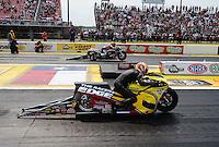 May 1, 2011; Baytown, TX, USA: NHRA pro stock motorcycle rider Michael Phillips (near) races Eddie Krawiec during the Spring Nationals at Royal Purple Raceway. Mandatory Credit: Mark J. Rebilas-