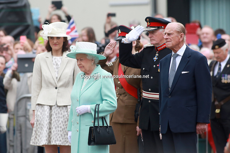 Britain's Queen Elizabeth II and the Duke of Edinburgh gather outside the Coleraine town hall to pay their respects to the dead of World War 1, as they finish their three day tour of Northern Ireland, Wednesday June 25, 2014. Photo/Paul McErlane