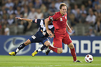 MELBOURNE, AUSTRALIA - OCTOBER 30: Adam Hughes of United breaks away from Marvin Angulo of the Victory during the round 12 A-League match between the Melbourne Victory and Adelaide United at Etihad Stadium on October 30, 2010 in Melbourne, Australia.  (Photo by Sydney Low / Asterisk Images)