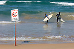 Manly Beach, New South Wales, Australia; surfers entering the water near stong current warning sign © Matthew Meier, matthewmeierphoto.com All Rights Reserved