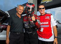 Aug 31, 2014; Clermont, IN, USA; NHRA funny car driver Bob Tasca III (center) and father Bob Tasca Jr (right) with former pro stock driver Bob Glidden during qualifying for the US Nationals at Lucas Oil Raceway. Mandatory Credit: Mark J. Rebilas-USA TODAY Sports