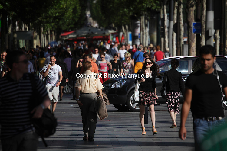 Young Parisian woman walking on Champs-Élysées Champs Elysees Avenue. City of Paris. Paris. France