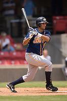 Montgomery first baseman Gabby Martinez (30) follows through on his swing versus Carolina at Five County Stadium in Zebulon, NC, Wednesday, July 18, 2007.