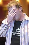 Greg Werbrich reacts after winning a hand.