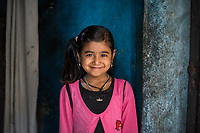 Nepal, Kathmandu, Nag Pokhari. Laxmi was helped by the Nepal Youth Foundation and fed when she was younger. Ten years old. Model released