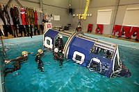 "Norwegian Air Ambulance crew train at Nutec facility near Oslo. The ""heli dunker"" is used to  train aircrew and escape from a helicopter crash into a body of water."