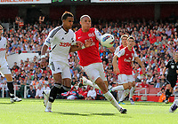 Pictured L-R: Scott Sinclair of Swansea challenged by Kieran Gibbs of Arsenal. Saturday 10 September 2011<br />